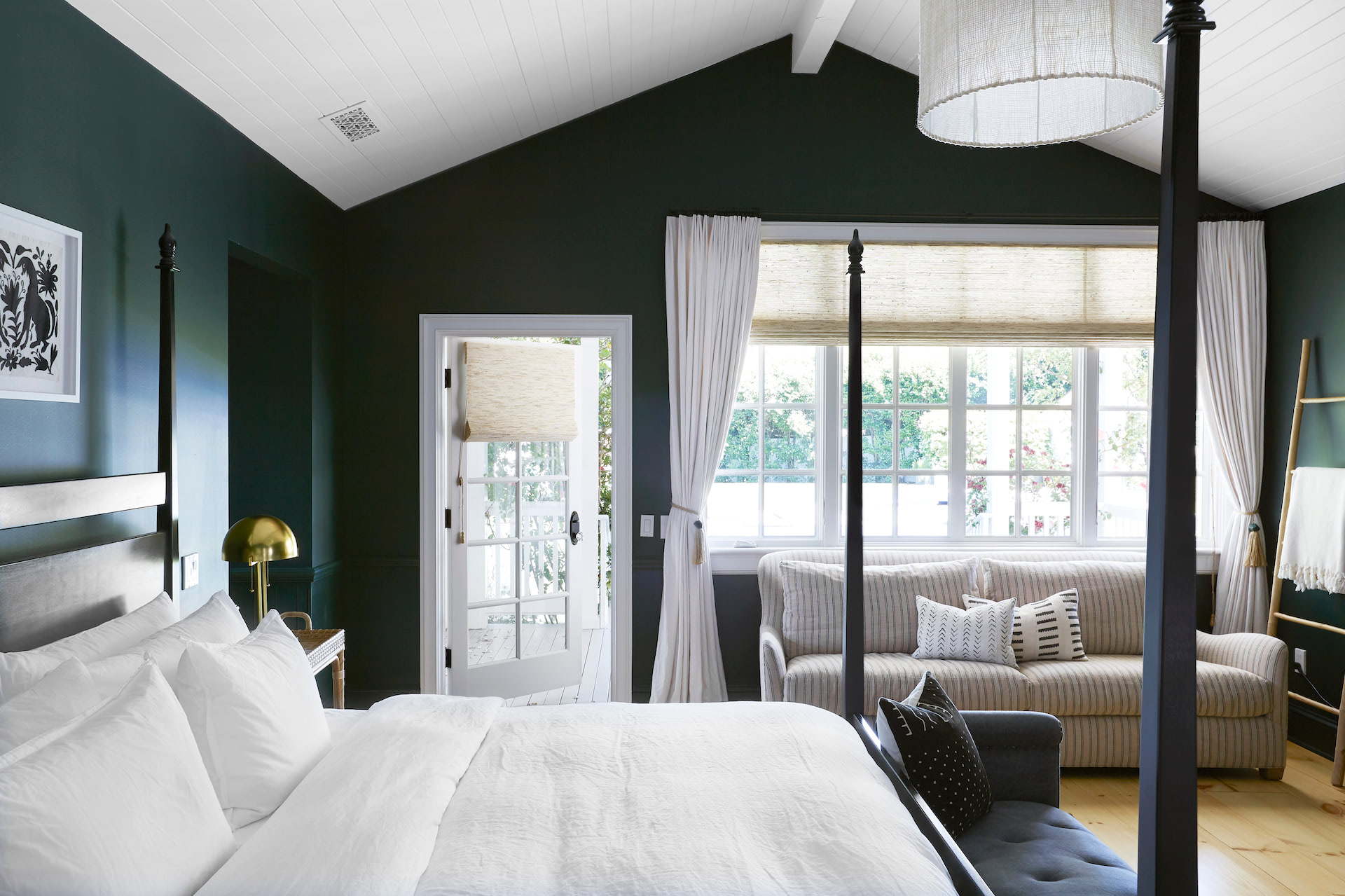 A bedroom with custom drapes for a glass door leading outside | Everhem