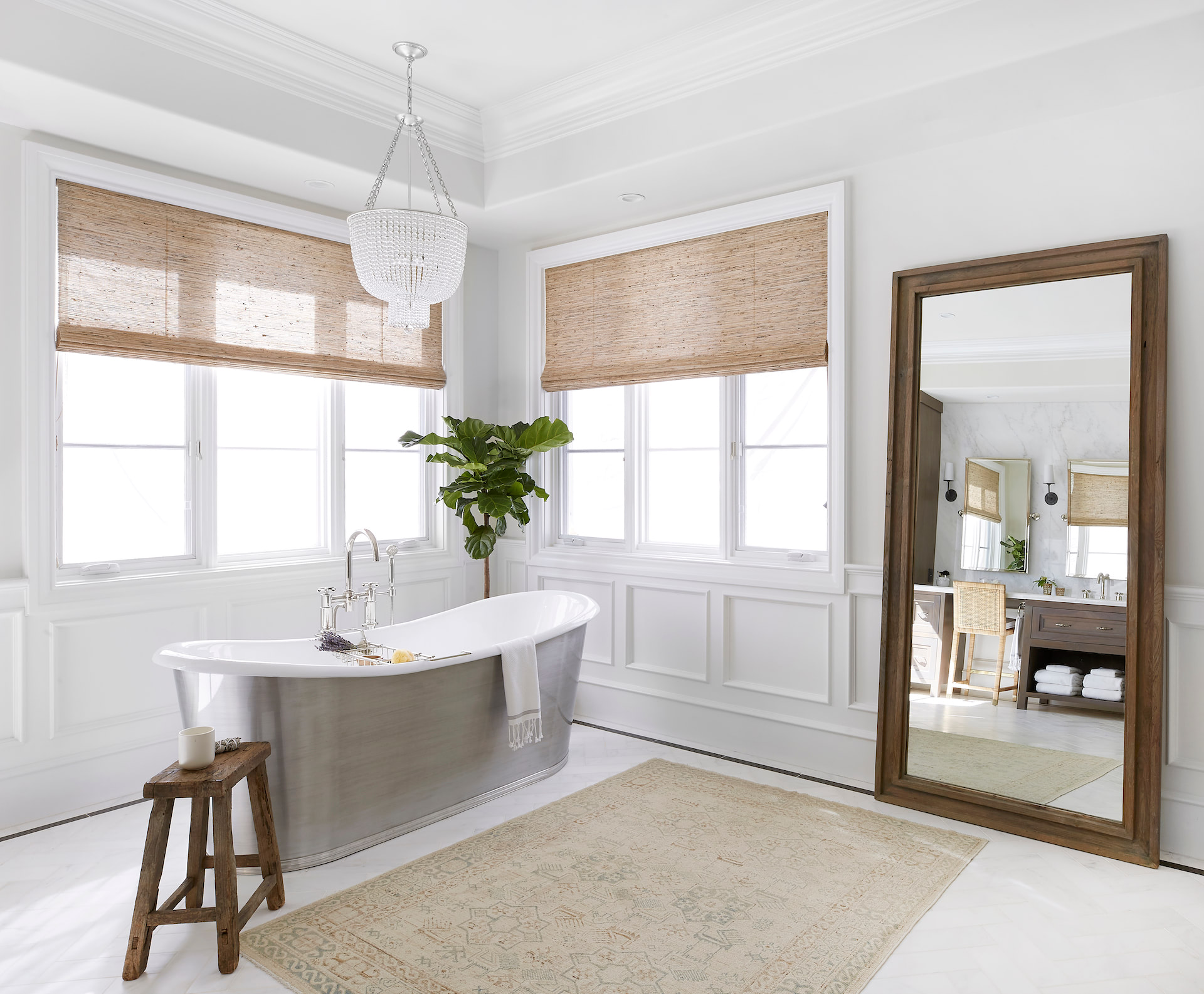 A bathroom with a large tub and two windows covered by woven woods | Everhem