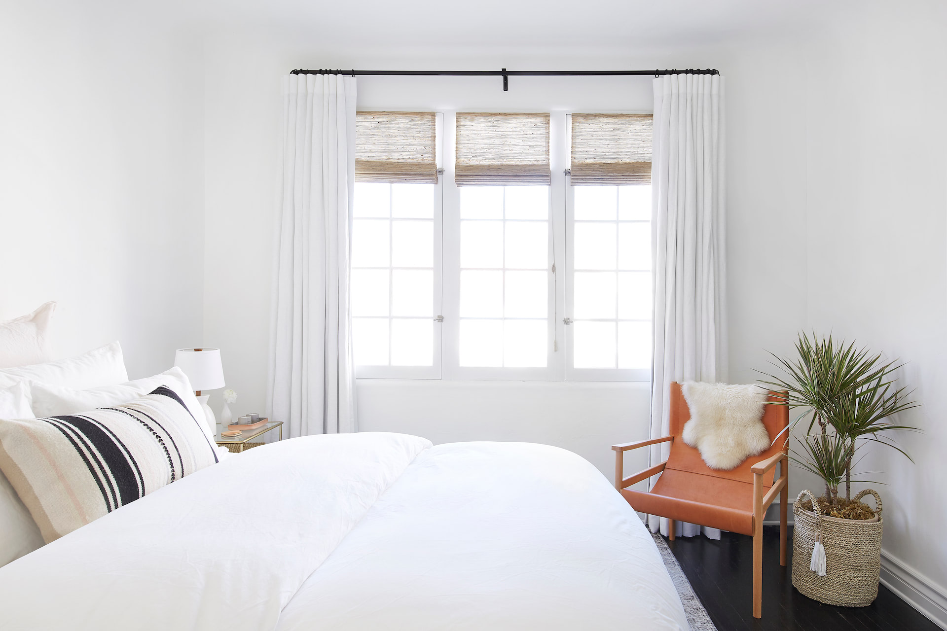 A bedroom with custom window treatments covering the windows | Everhem