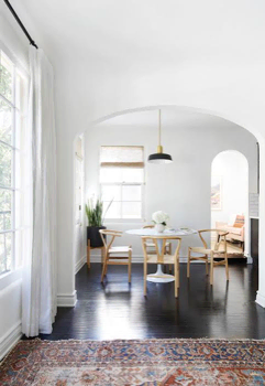 A Spanish Scandinavian home with both woven wood shades and linen drapes | Everhem