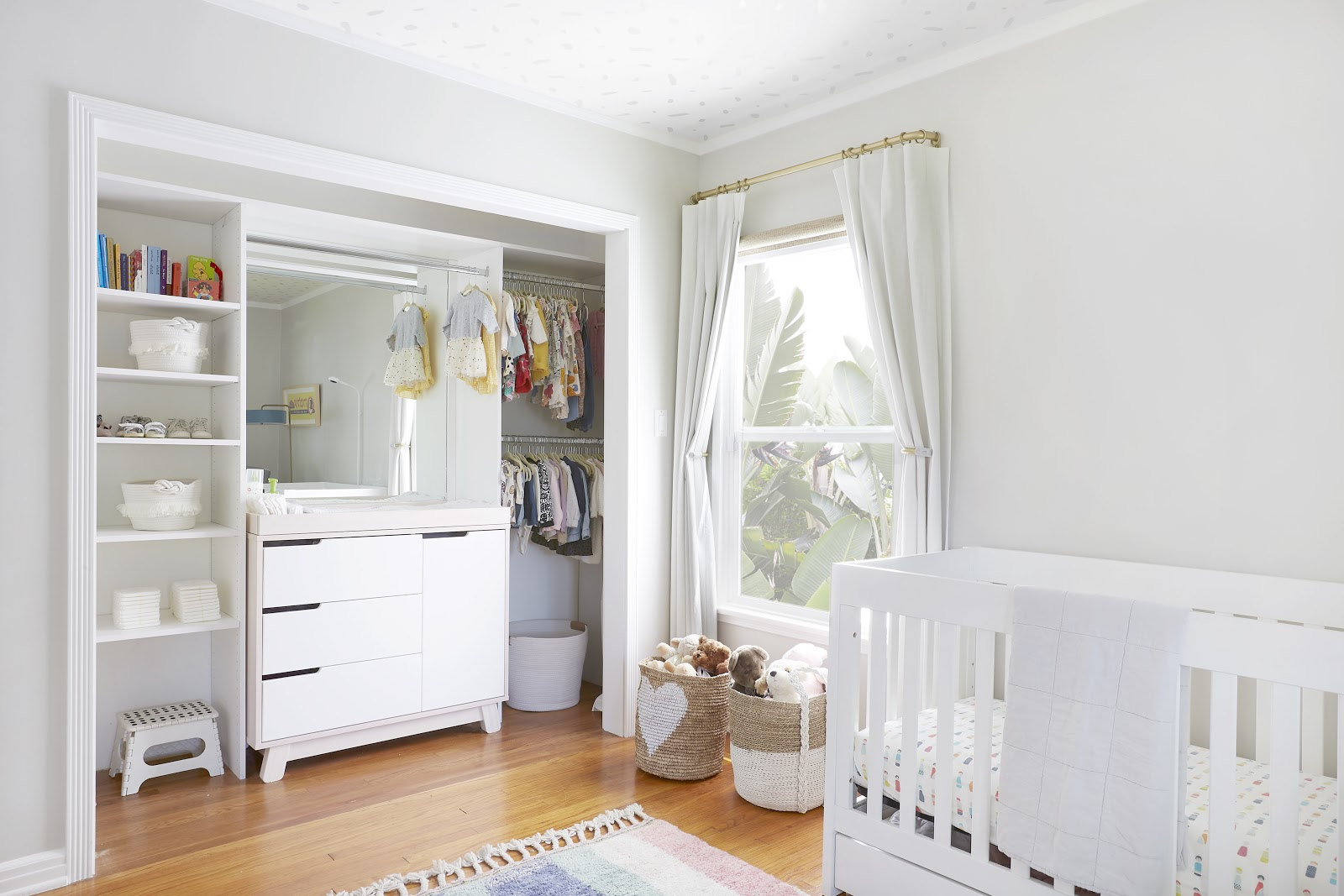 A baby bedroom with open curtains looking to the yard | Everhem