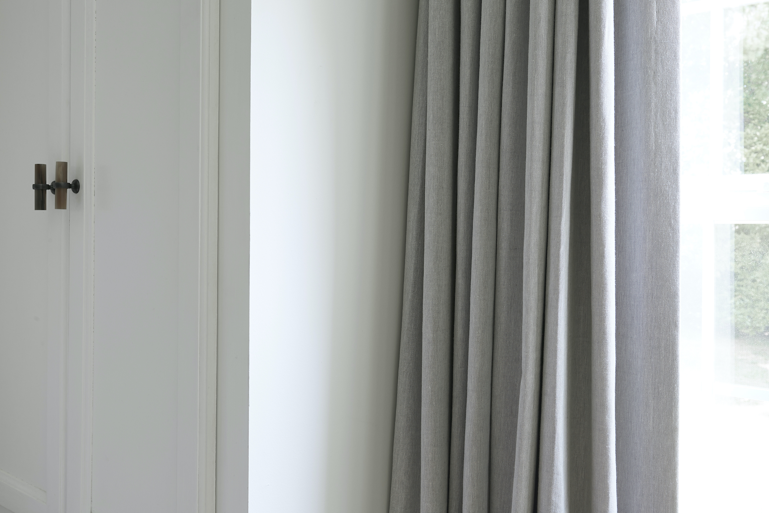These flint-gray linen curtains, open & folded, shows how elegant & airy drapery fabric can be.