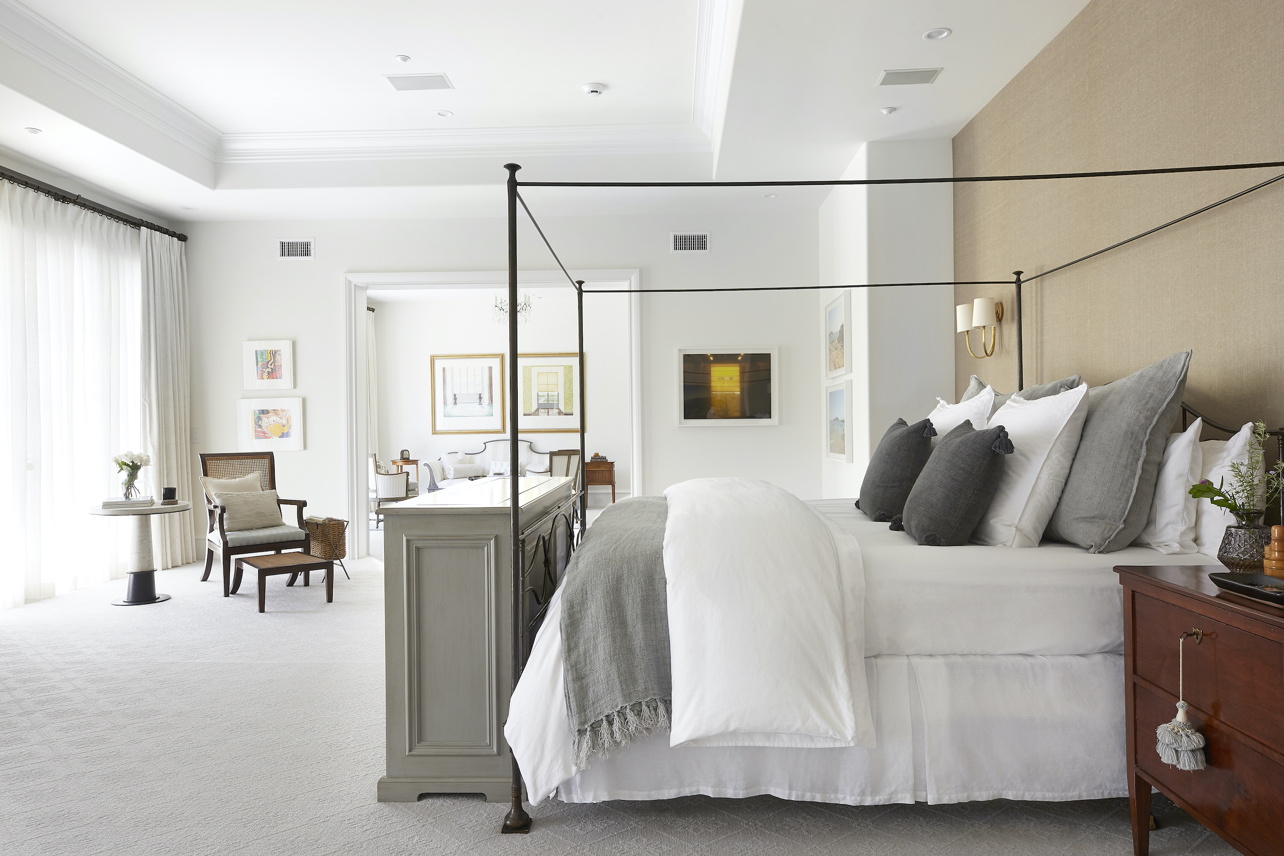 Two layers of window treatments creates exceptional privacy in a grand master bedroom
