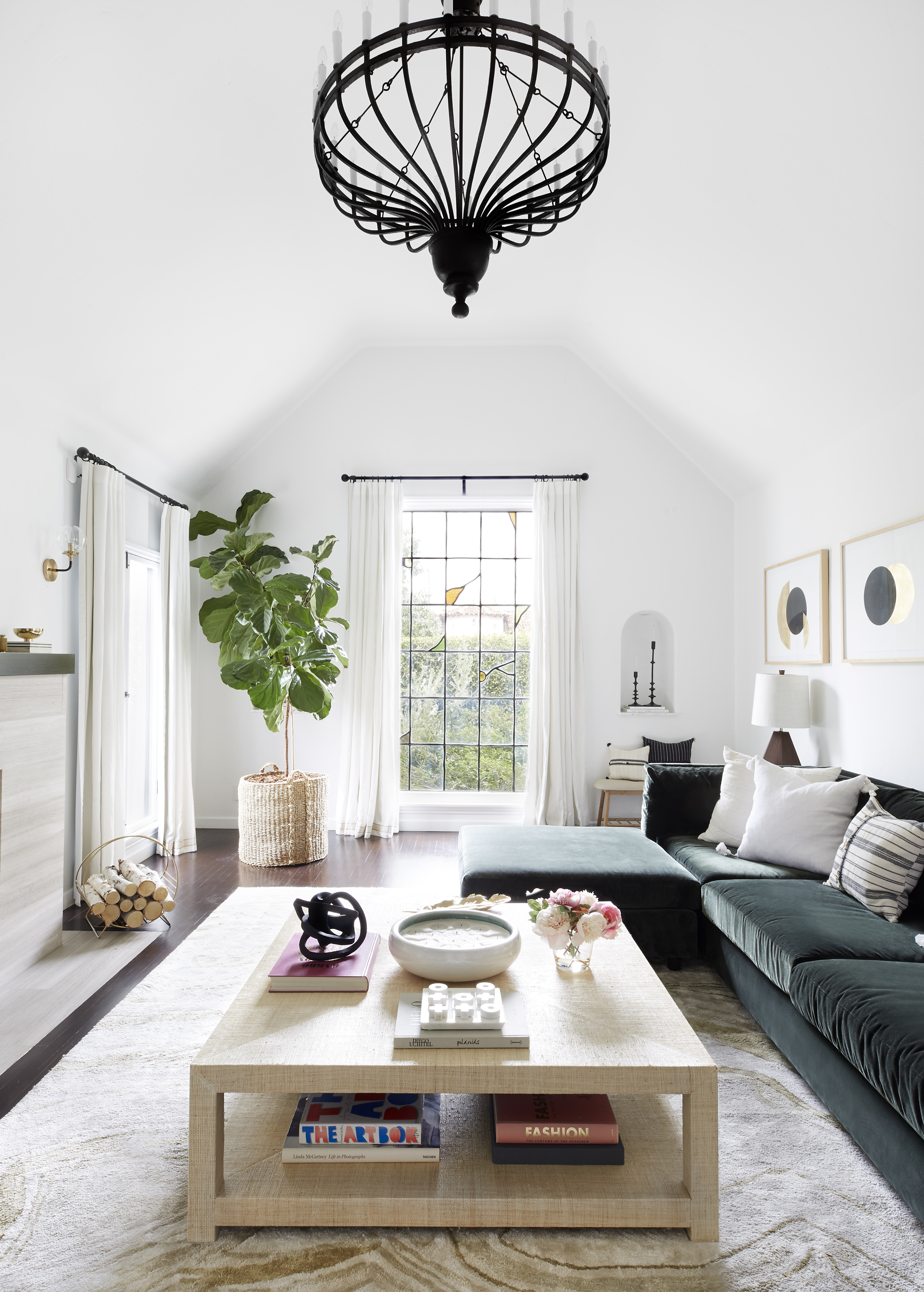 Large window coverings are mounted above the frame to add height and interest in the living room