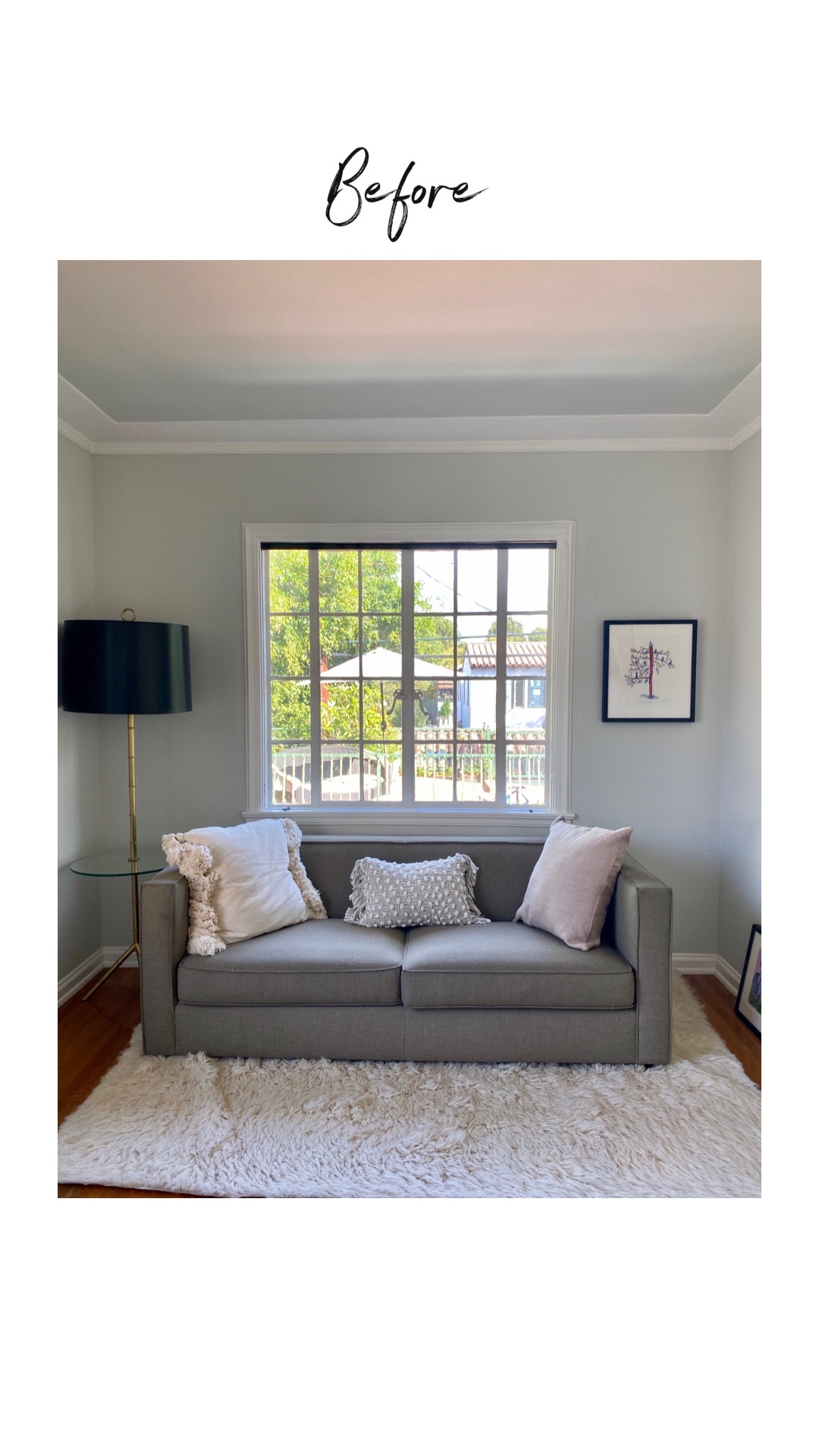 A relaxed living room with modern-style couch, shag rug and a large window with no coverings