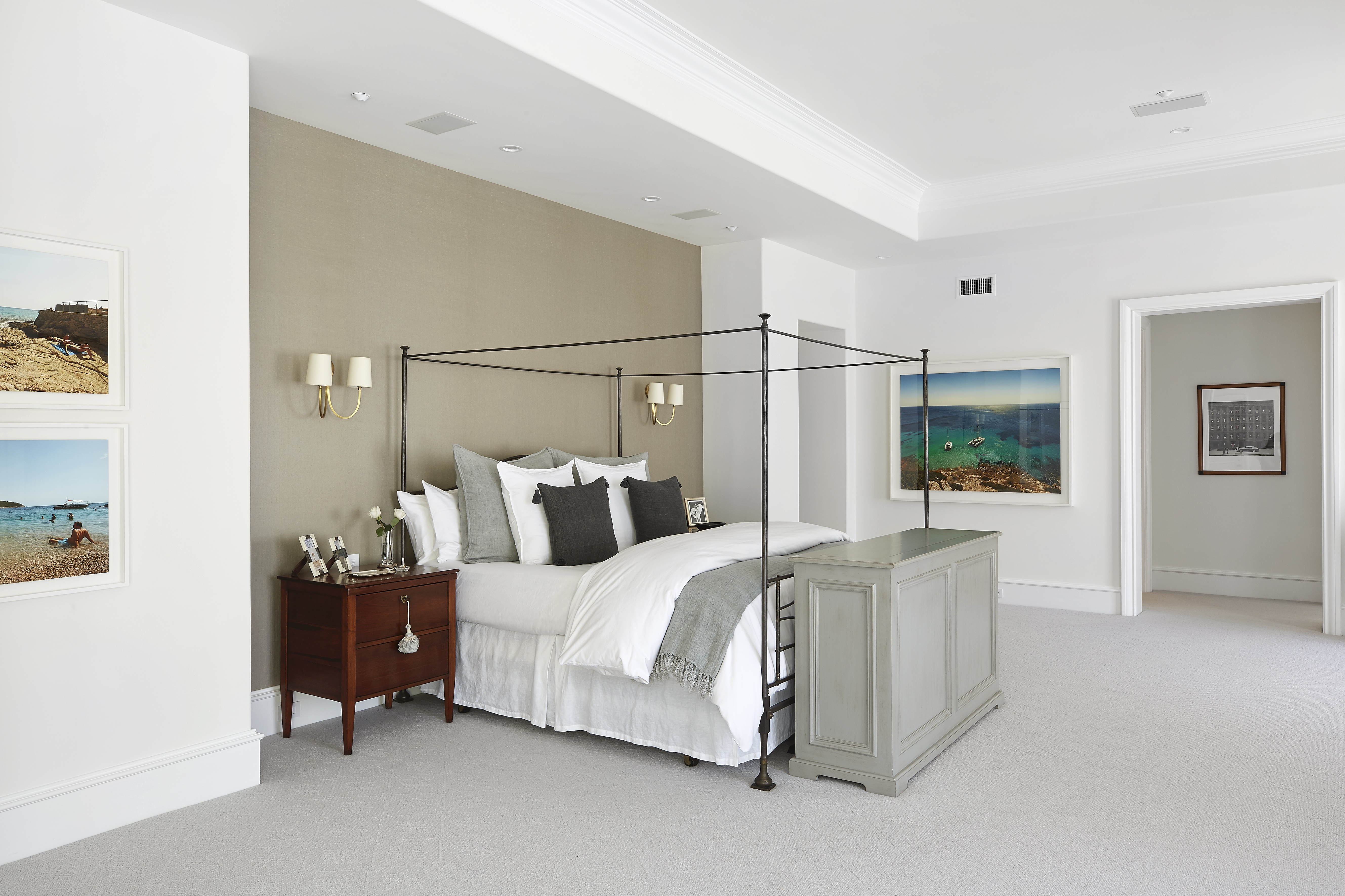 Neutral walls, carpet and bedding makes this master suite a sleep sanctuary