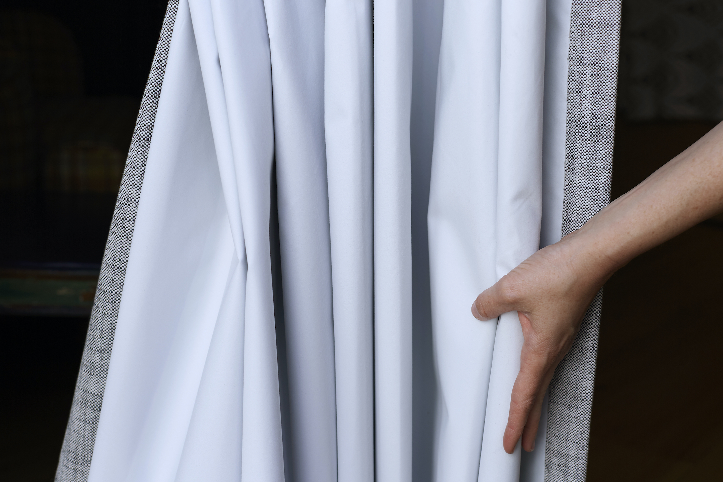 A close look at blackout lining on linen drapes that are the perfect way to be energy efficient
