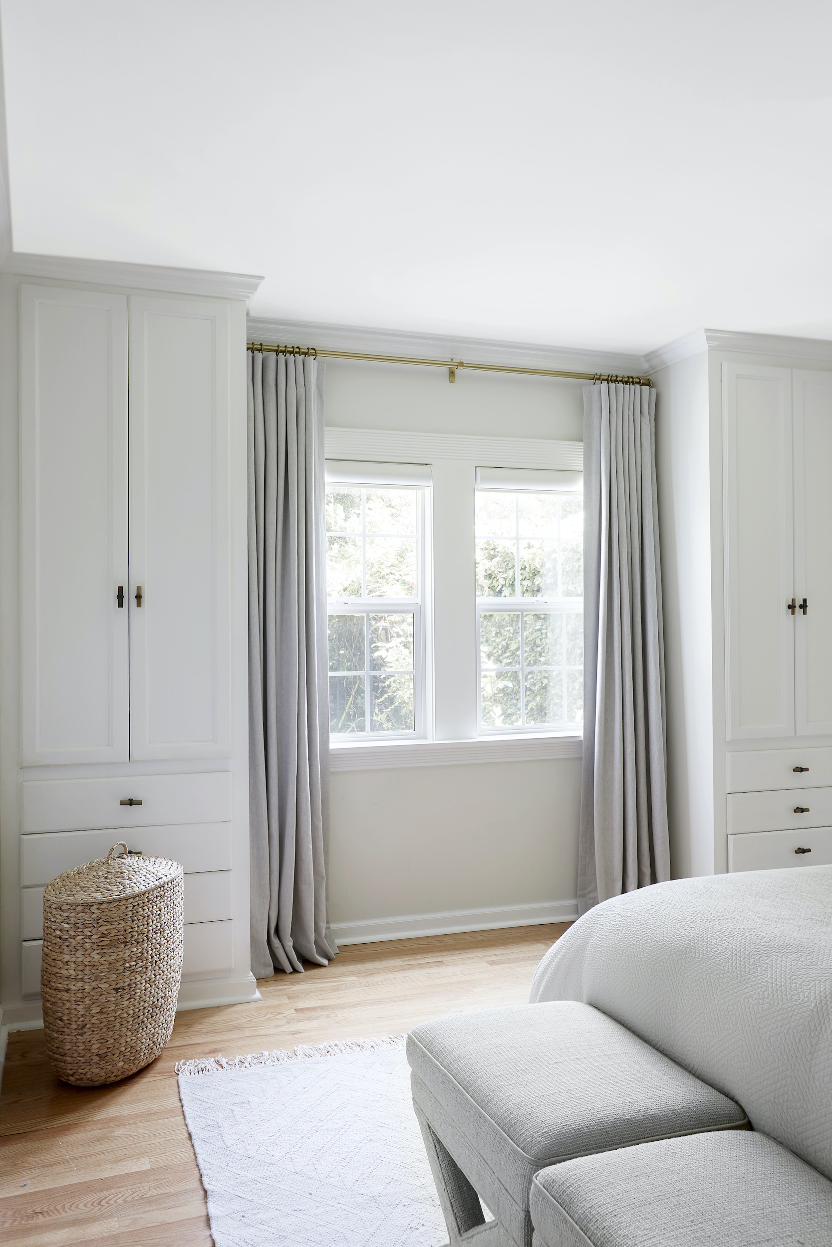 Everhem linen drapery in neutral gray tone hangs open in modern master bedroom