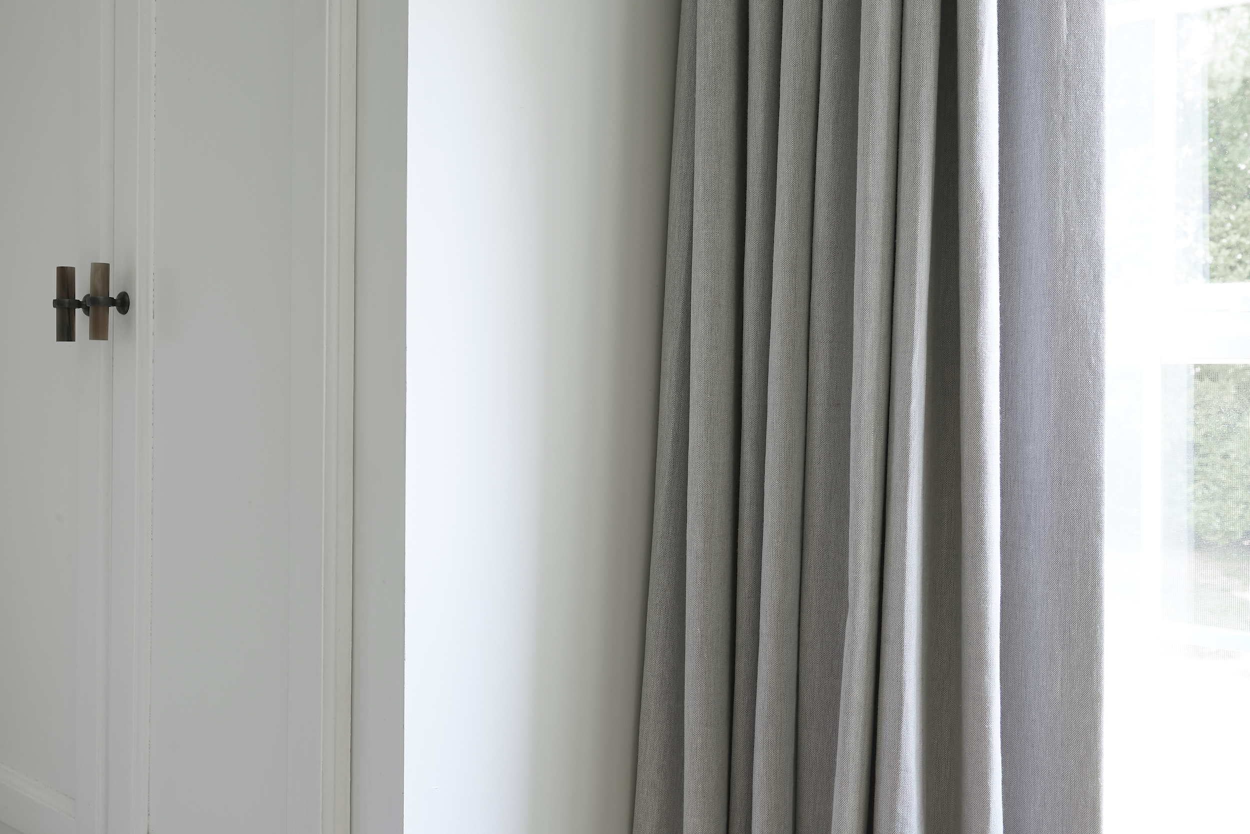 Close-up of Everhem linen blend drapery as energy-efficient window treatments for the winter