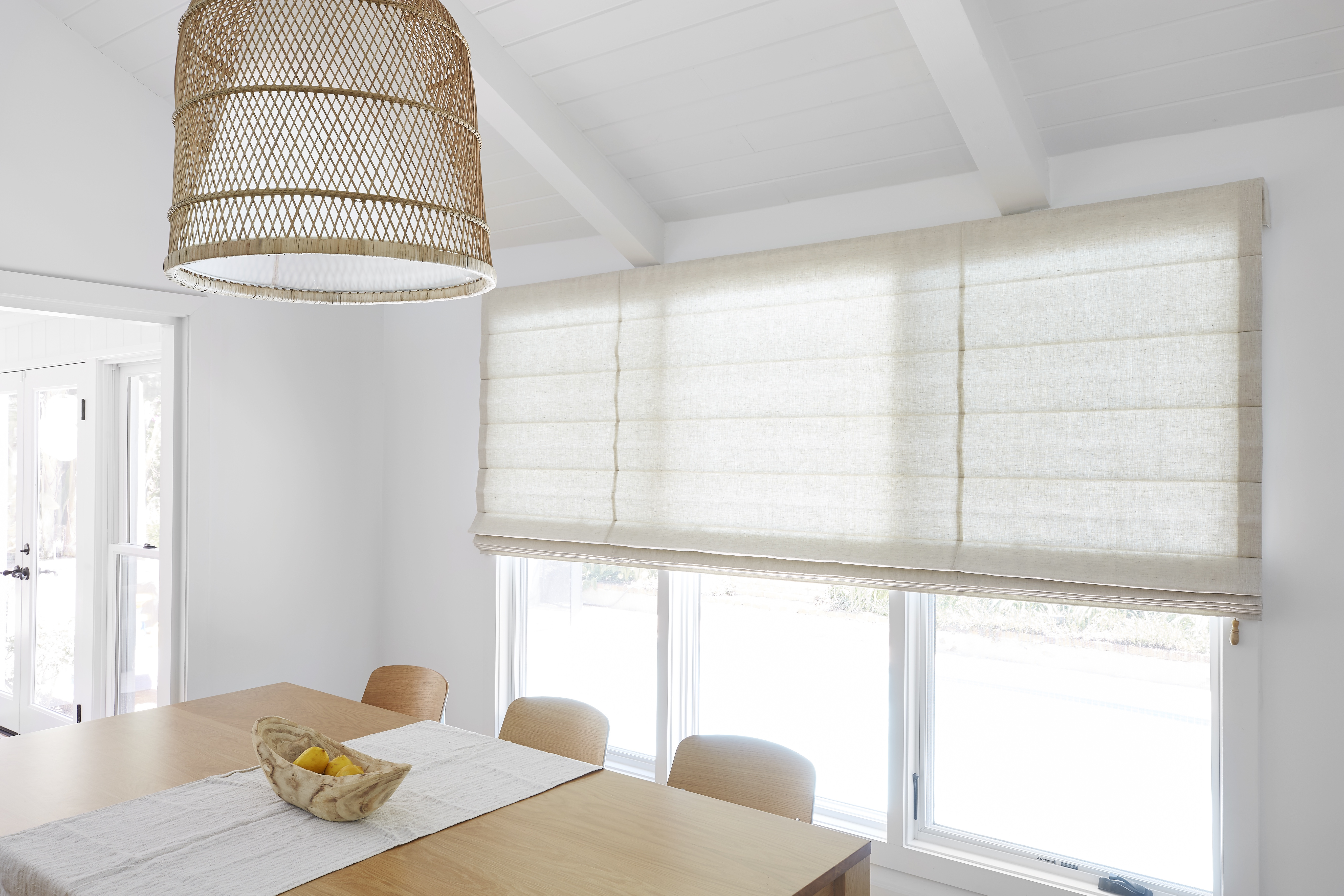 Evehem flat Roman shades are half-closed in light, bright modern-style dining room.