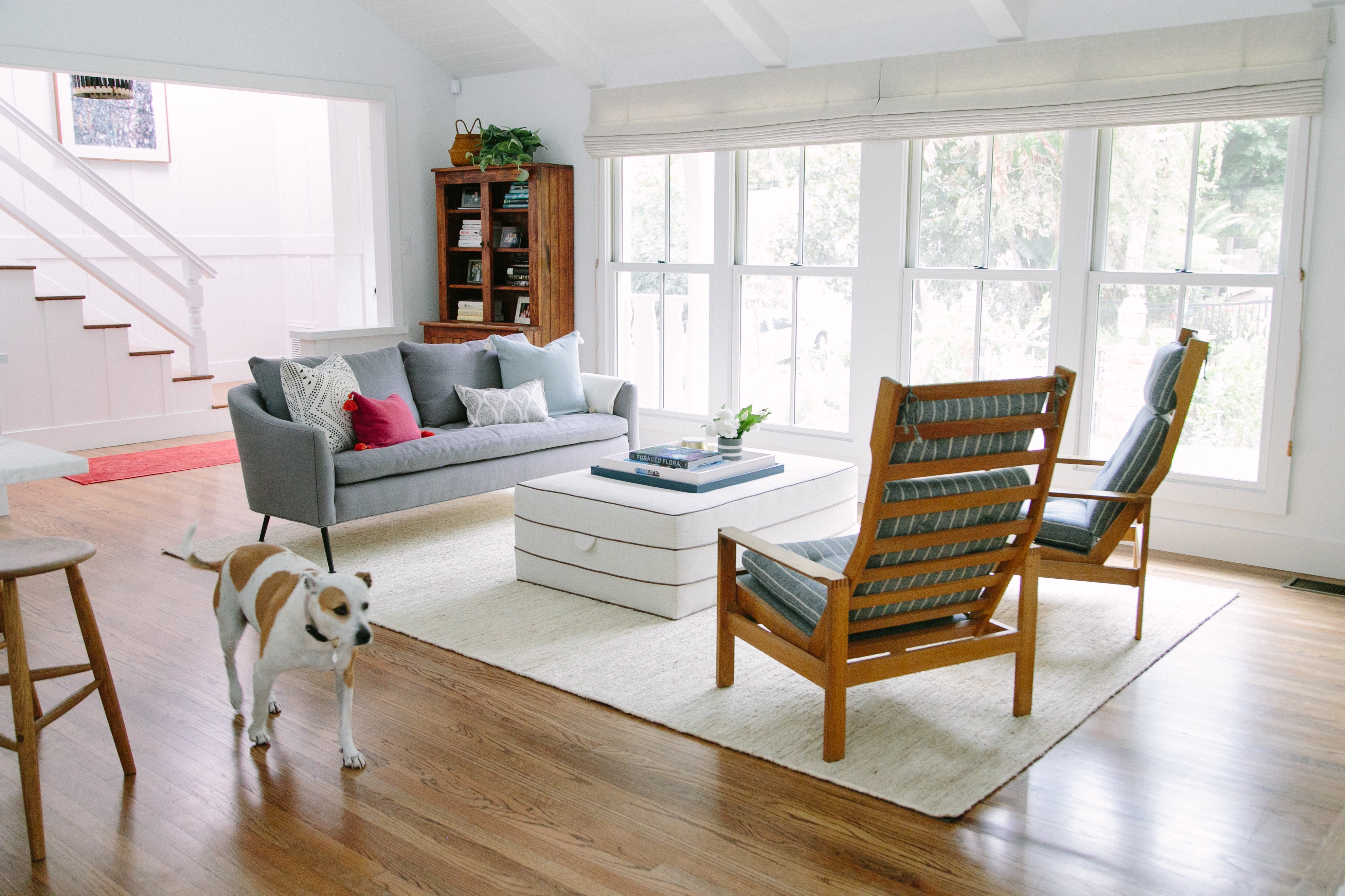 Choosing window treatments for Cape Cod-style living room might mean Roman shades in a neutral tone | Everhem