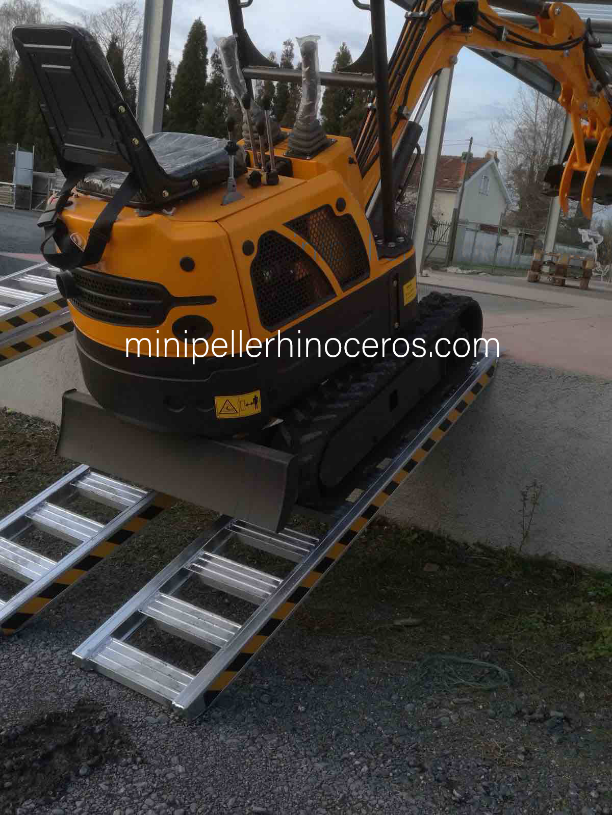 Loading of a Mini Excavator