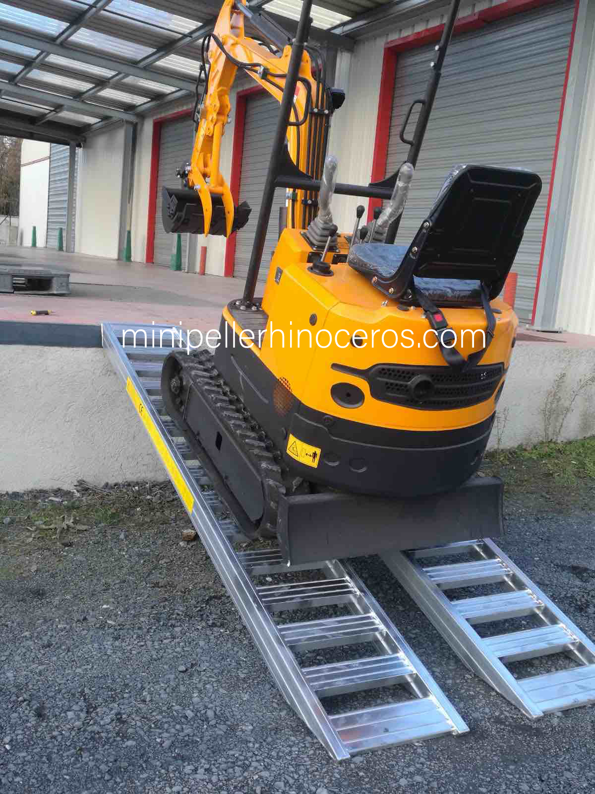 Loading of a Mini Excavator aluminium ramps