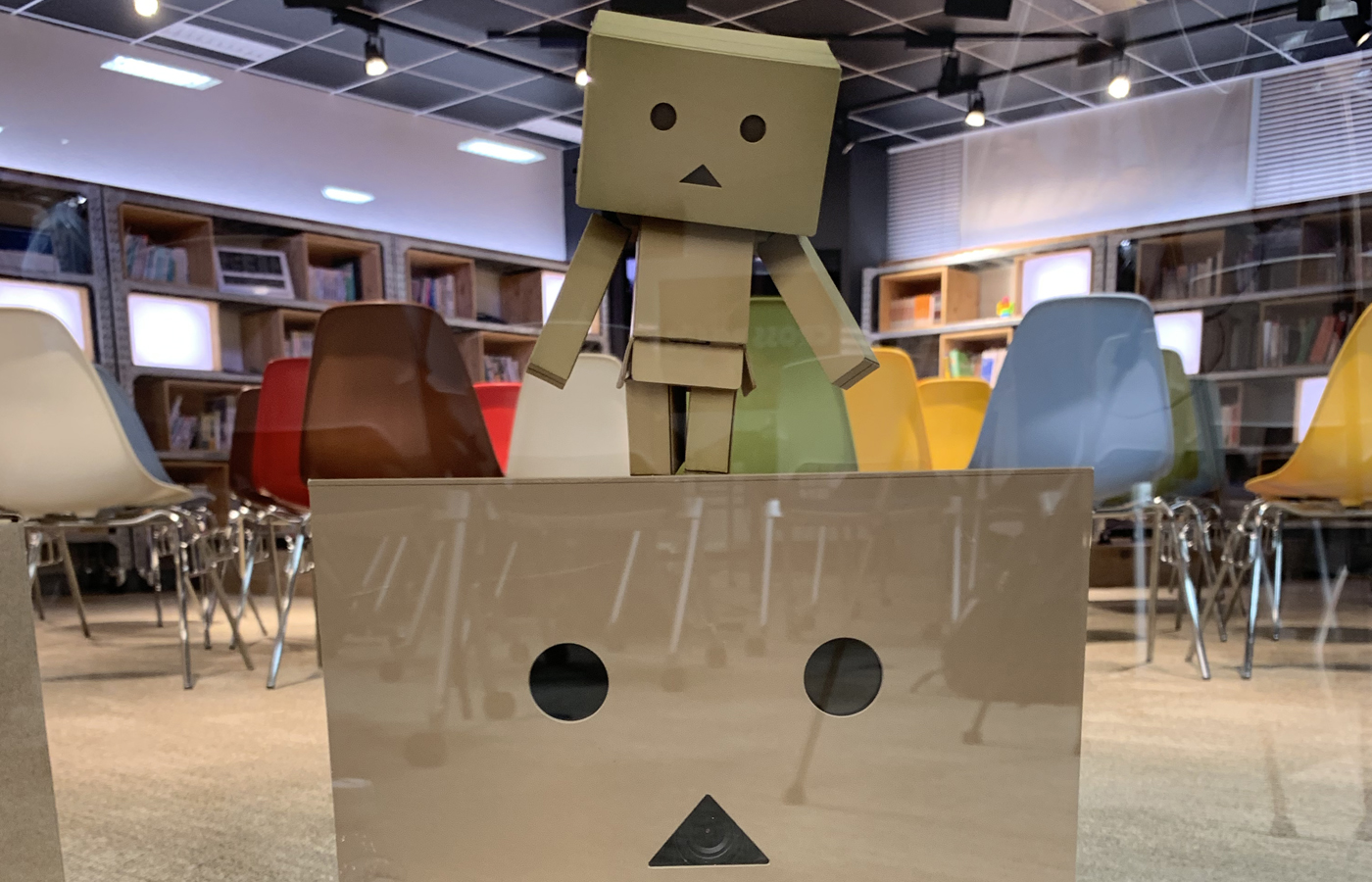 Cardboard robots enjoying the presentation