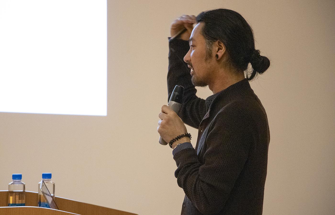 Keisuke Suzuki presenting