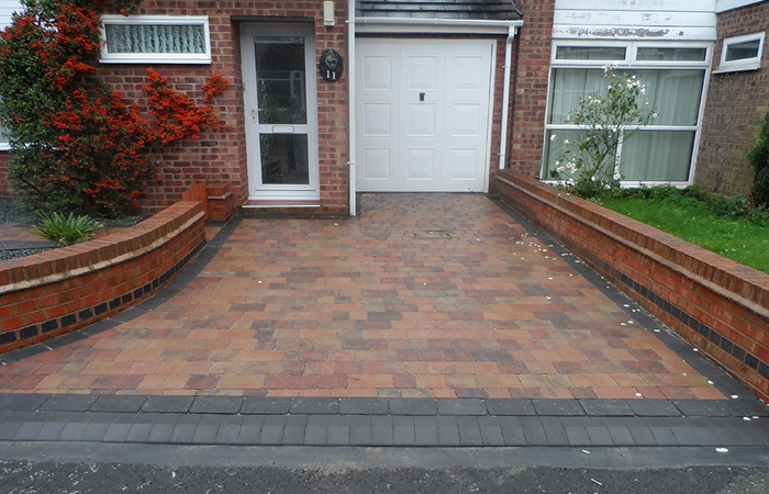 Autumn mix Rumbled paving set driveway and path with single borders in charcoal, K.L kerb set frontage and welsh green granite gravel area.