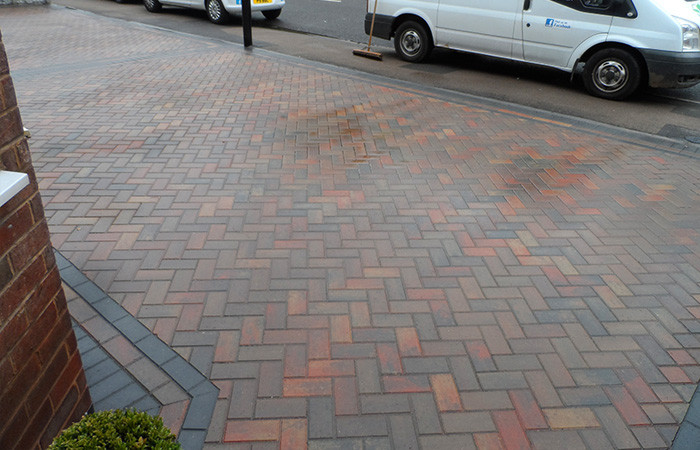 Autumn mix standard paving set double driveway with triple borders in charcoal and new fences.
