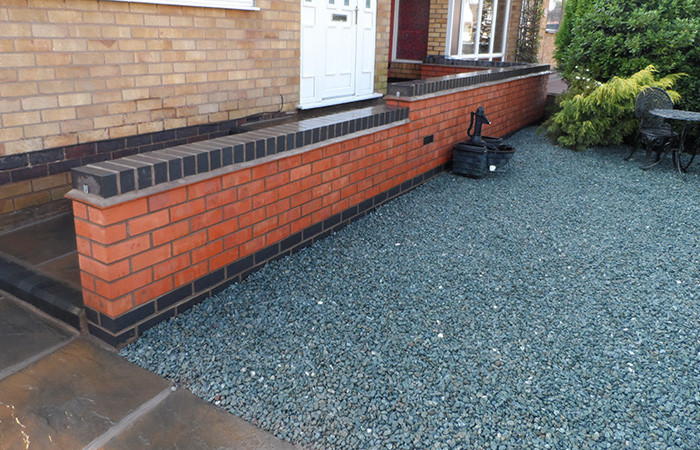Retaining wall with disability steps using K.S kerb sets and Rutland autumn gold slabs.