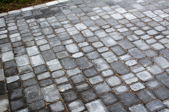 Charcoal Rumbled paving set driveway with Ash border.
