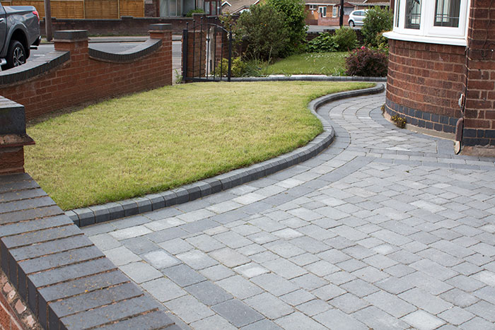 Ash Rumbled paving set driveway with triple border in charcoal, new lawn area retained with K.S kerb sets.