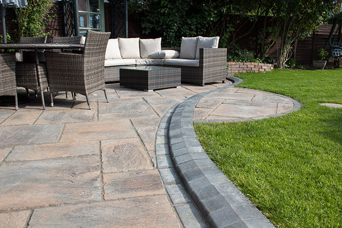 Mixed size autumn gold concrete patio and standard charcoal blocks, steps built from charcoal kerbs and matching autumn gold steppingstones.