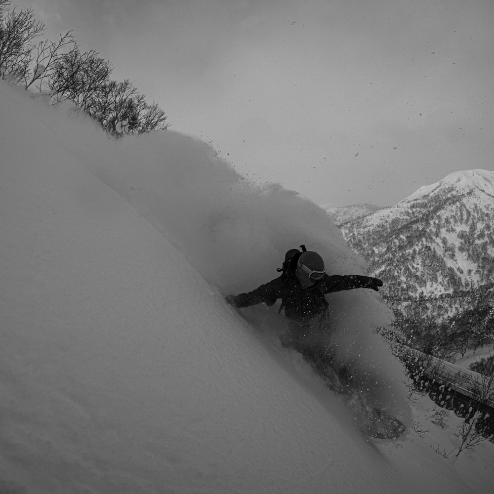 Luke snowboarding in Hokkaido
