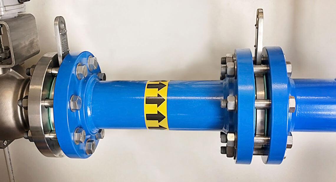 Mutli stage restriction orifice plates for pressure reduction in cavitation slurry