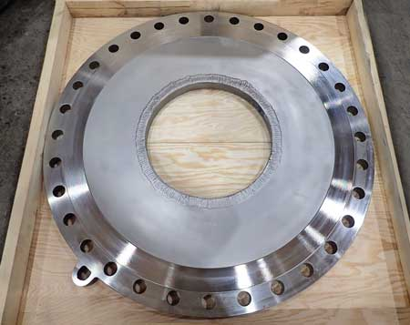 Custom restriction orifice plate for cavitation and vibration reduction