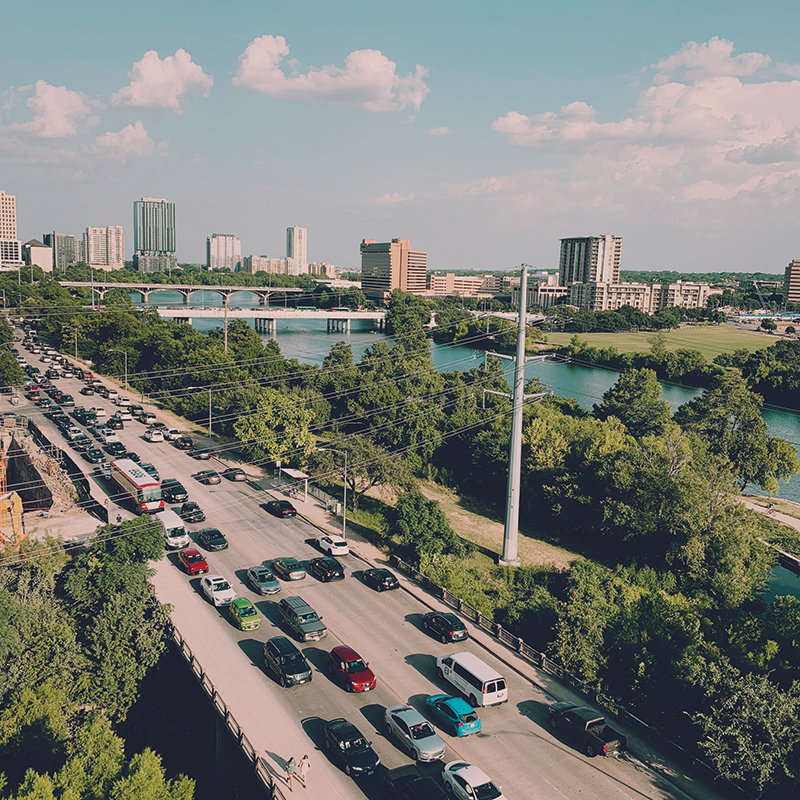 a picture depicting traffic lanes in austin next to ladybird lake