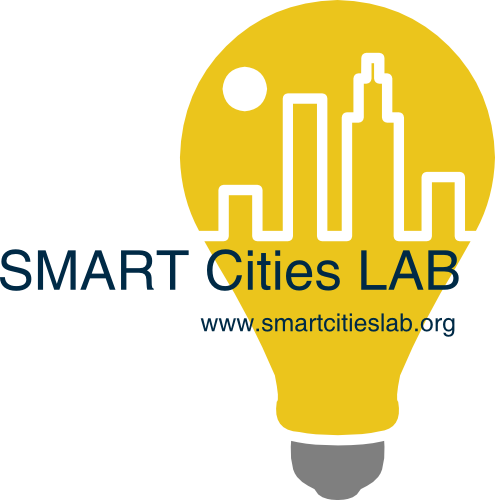 logo for the smart cities lab. features a yellow lightbulb with an outline of a city inside of it and the words smart cities lab overlaid on the logo