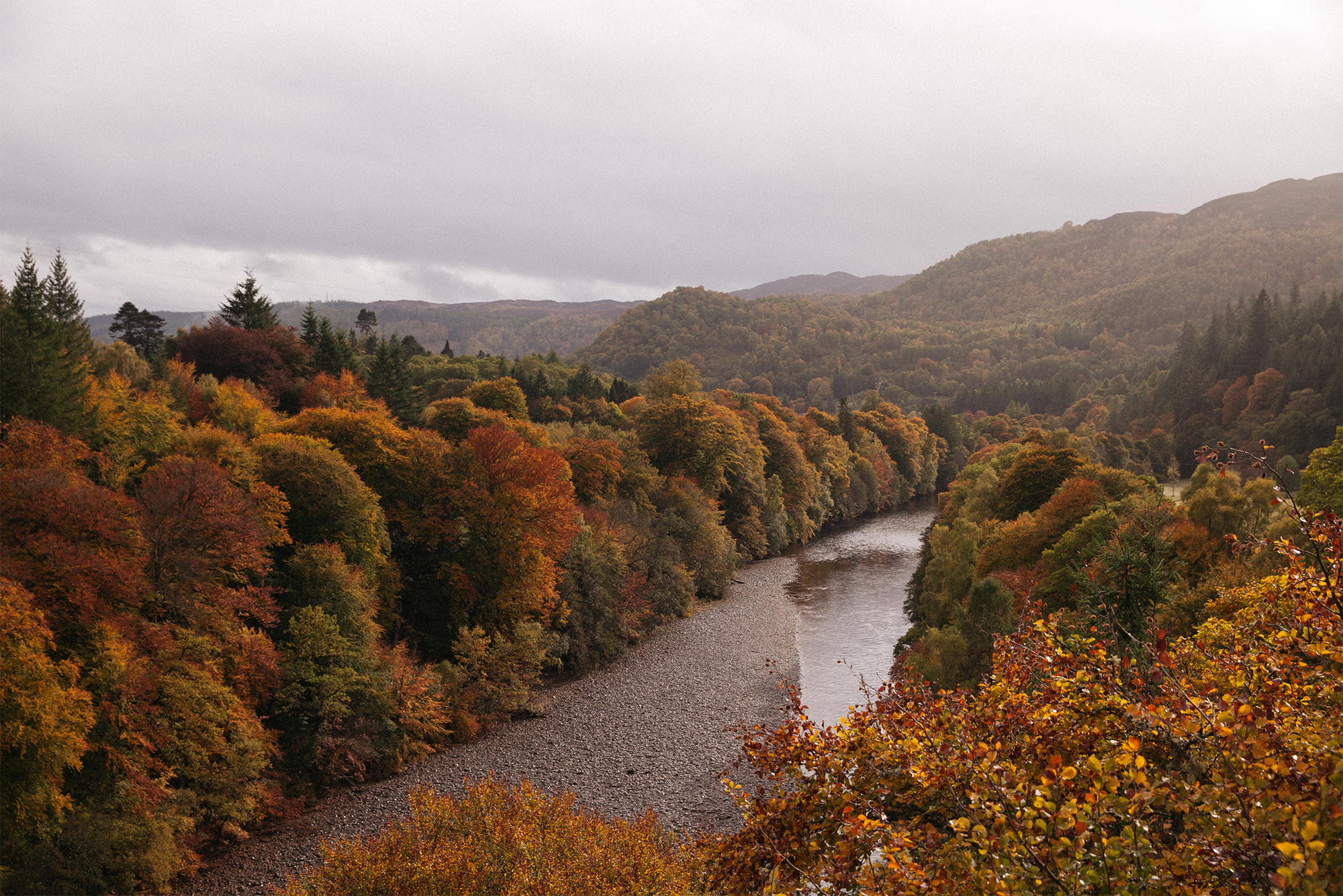 Strong autumnal colours overlooking the River Garry.