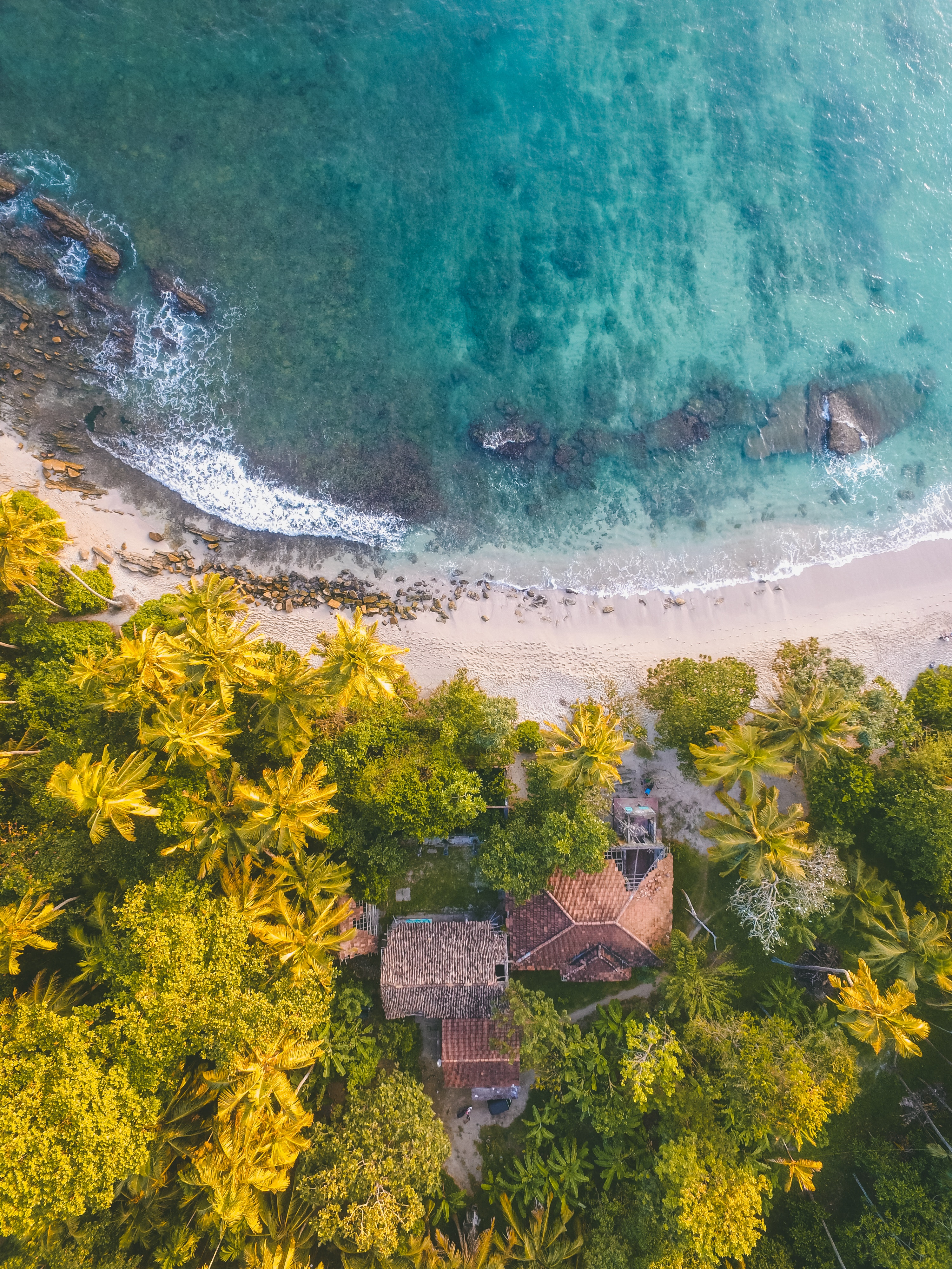 Birds eye view of beach front house on ocean