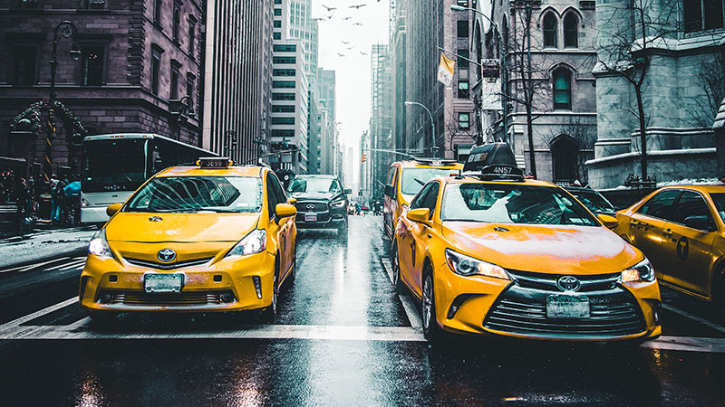 Taxis driving on a street in New York City
