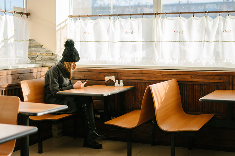 Girl eating out alone at a diner