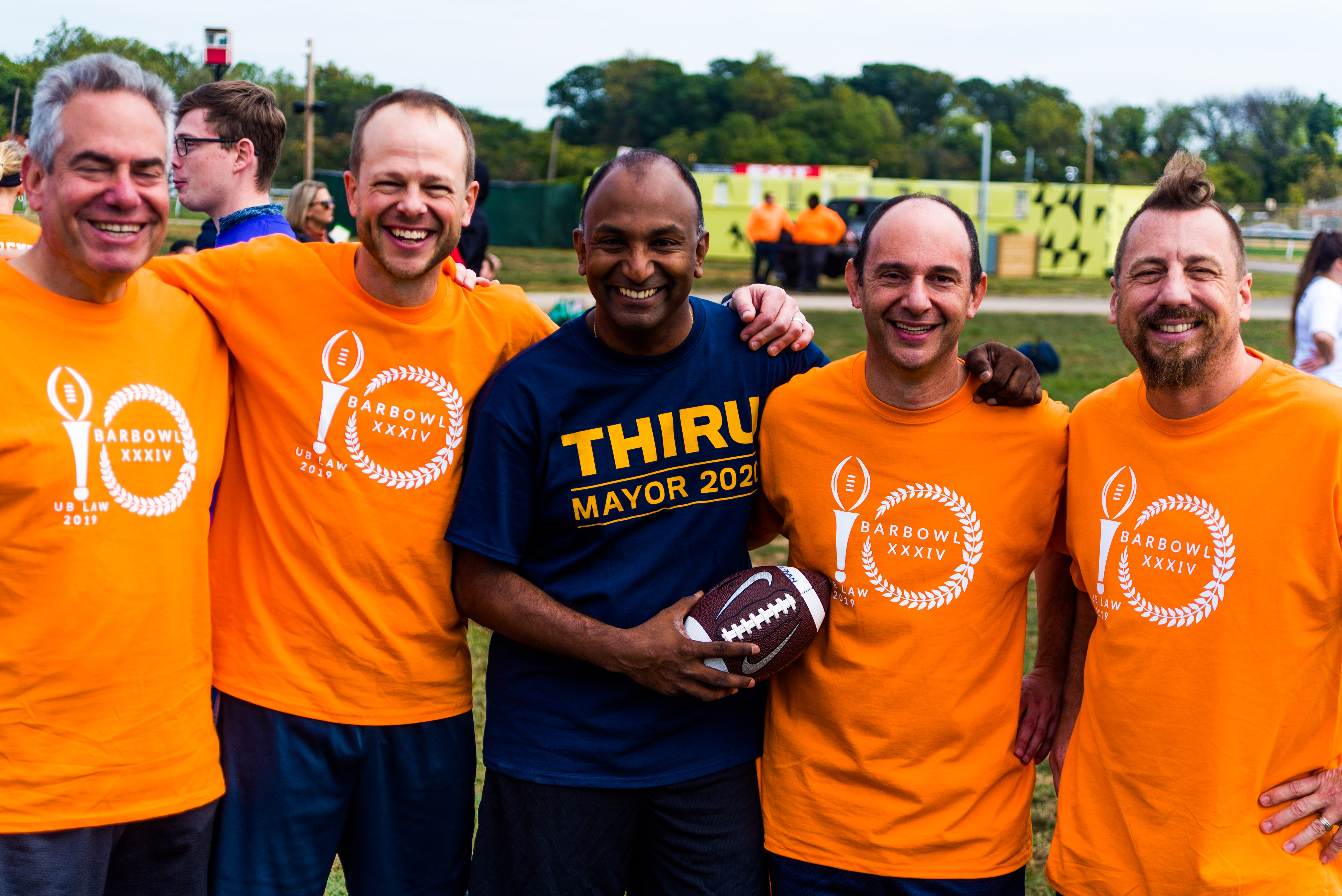 Thiru Vignarajah poses with other members of the UB Law faculty and alumni team at their 34th annual Bar Bowl flag football tournament