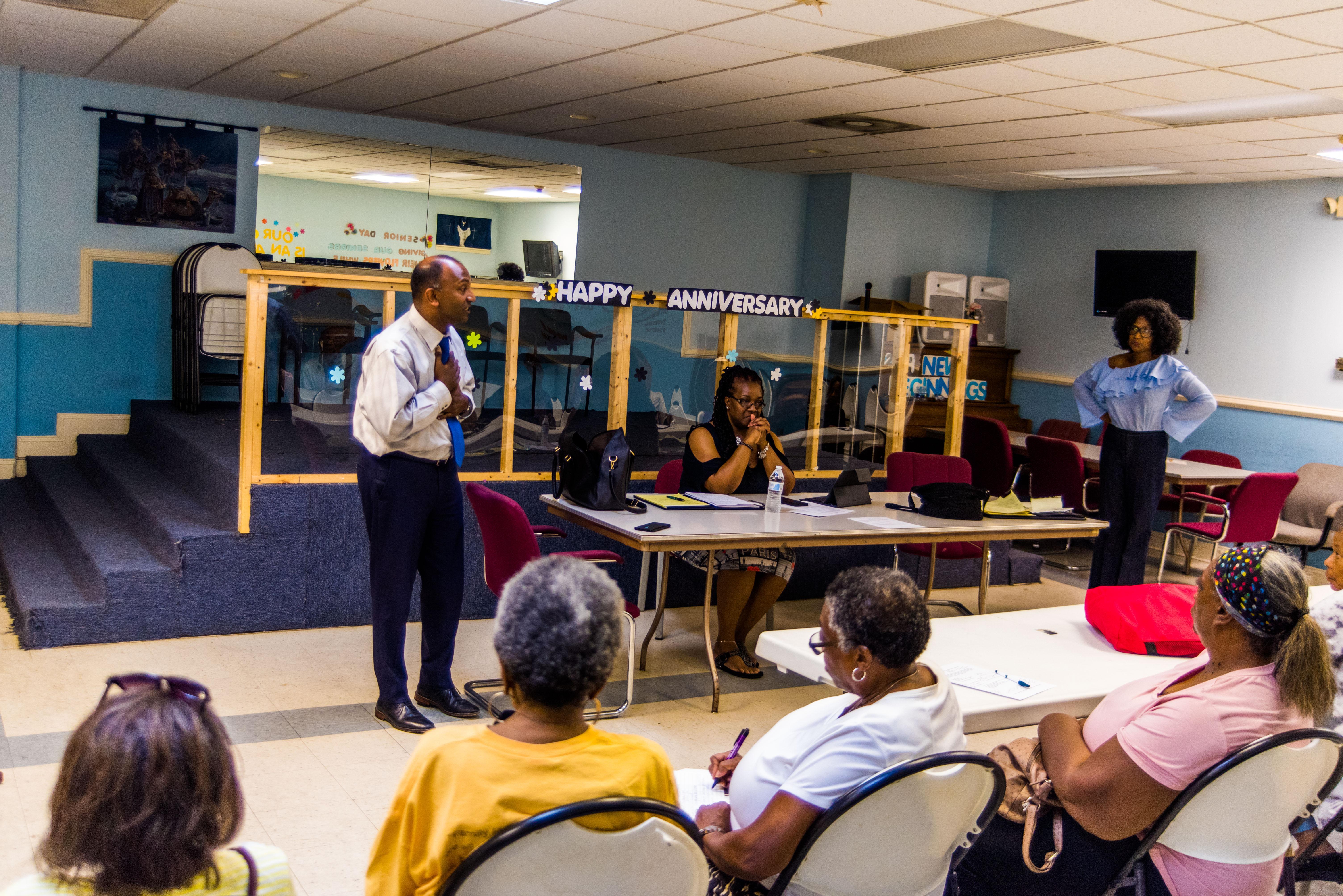 Thiru Vignarajah speaking at an Edmondson Village Community Association meeting