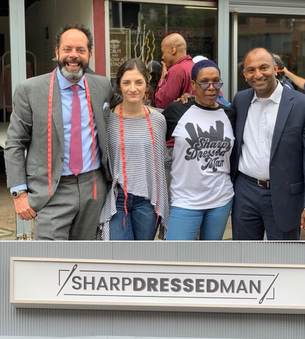 """Thiru stands with """"Sharp Dressed Man"""" a local non-profit that provides suits"""