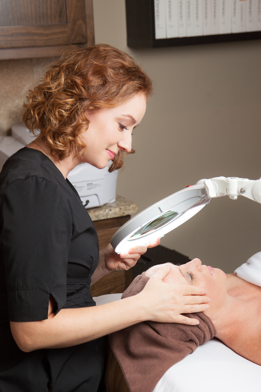 Laura Kitzmann providing acne treatment at Kitzie Spa.