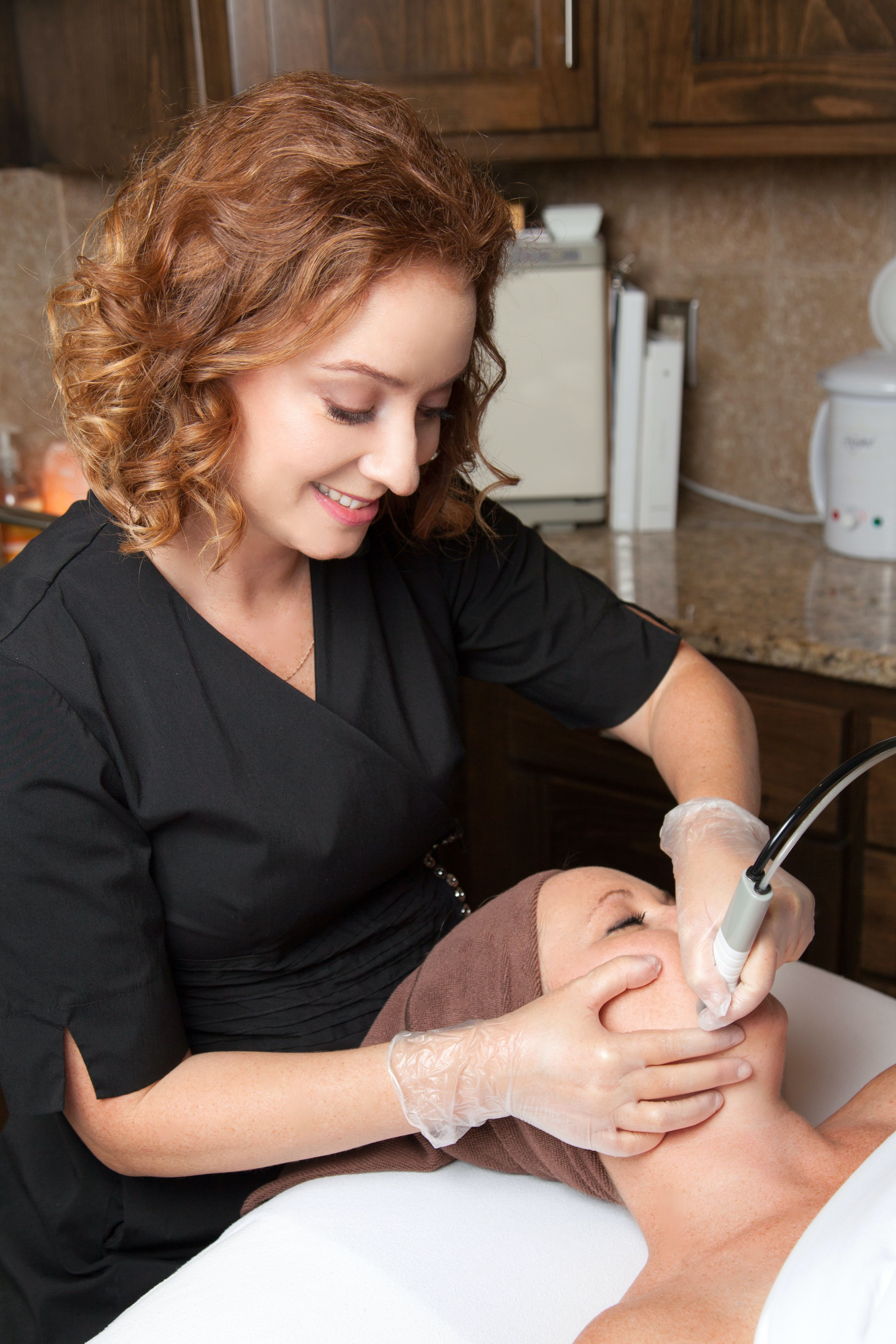 Laura Kitzmann doing a microdermabrasion skin care treatment at Kitzie Spa.