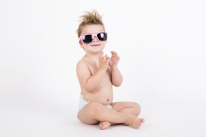 disheveled girl smiling wearing sunglasses with withe background