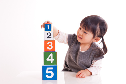 young girl playing with a, b, c's