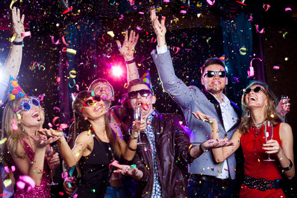 Cheerful  people showered with confetti on a club party.