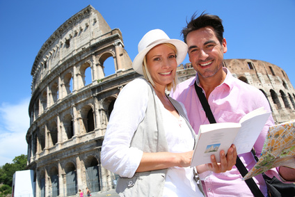 Couple in Rome reading guide book by the Coliseum