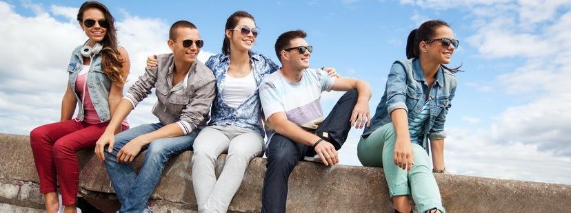 friends sitting on a ledge