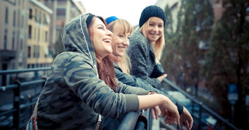 three friends woman in urban scene