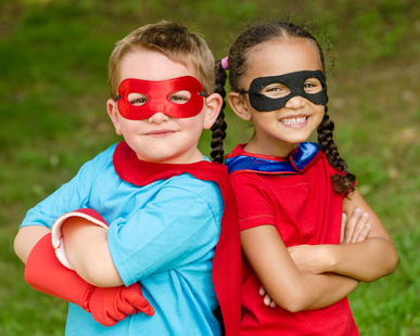 girl and boy pretending to be superheroes
