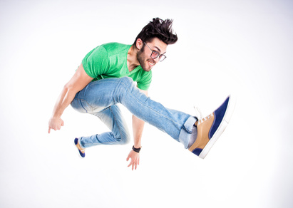 man dressed casual jumping and smiling  - dynamic wide angle shot
