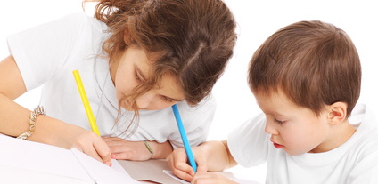 A picture of a young siblings doing homework over white background