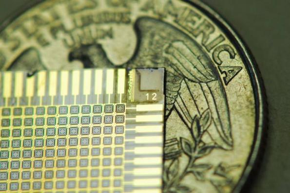 An Audio Pixel chip with an American coin.