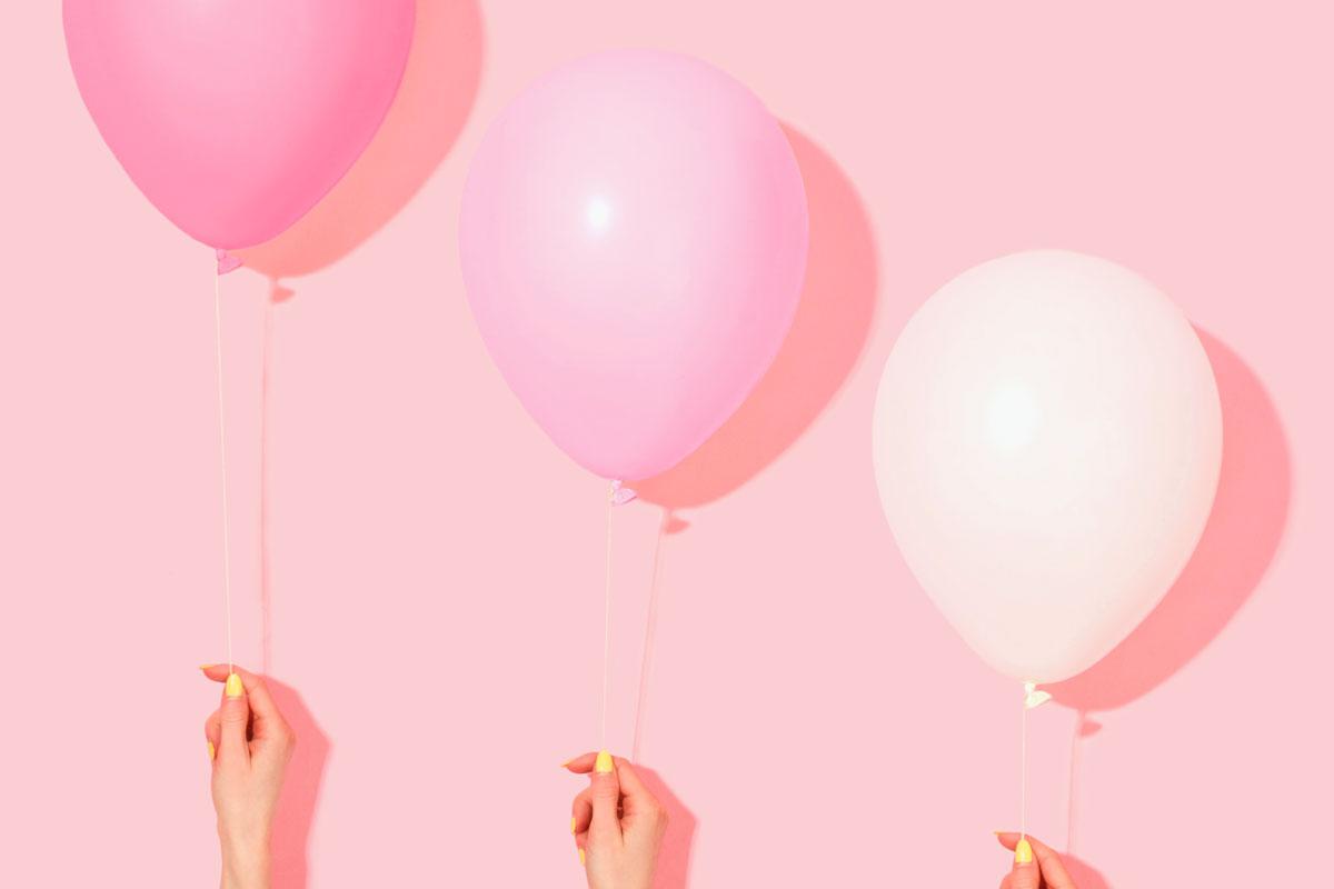 Three celebration balloons